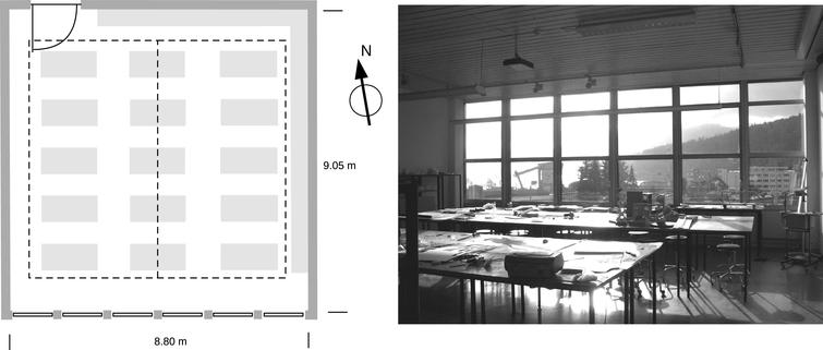 Plan view of the studio classroom used in our case study. The light grey fields indicate the furniture and the dashed line marks the sensor plane for the illuminance calculation. On the right, a photo of the room is shown, taken from the entrance facing the window facade.