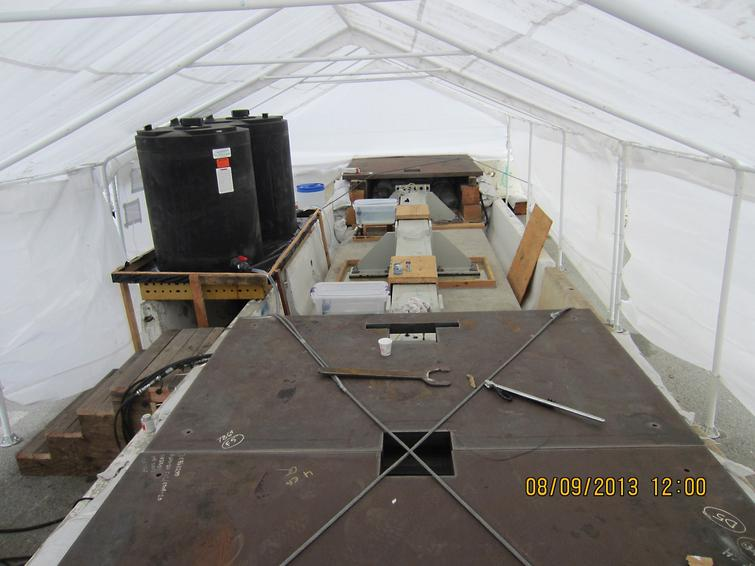The test in progress under protective tent.