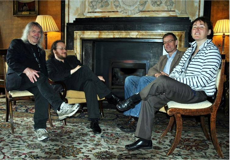 """Four of the five organisers of the programme """"Semantics & Syntax"""": S. Barry Cooper, Benedikt Löwe, Arnold Beckmann, Elvira Mayordomo (from left to right). Photo taken by Sara Wilkinson in the Old Combination Room at Corpus Christi College, Cambridge, June 2012."""