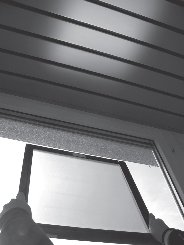Sample glass plate with a layer of the micro-structured film used in our case study held against a window on a sunny day, showing both the redirection effect on the ceiling and the reduced transmission for the direct view through the sample.
