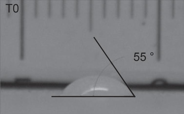 Water contact angle measurement just after drop pouring. The image is shadowed as the picture was taken before UV irradiation source activation.