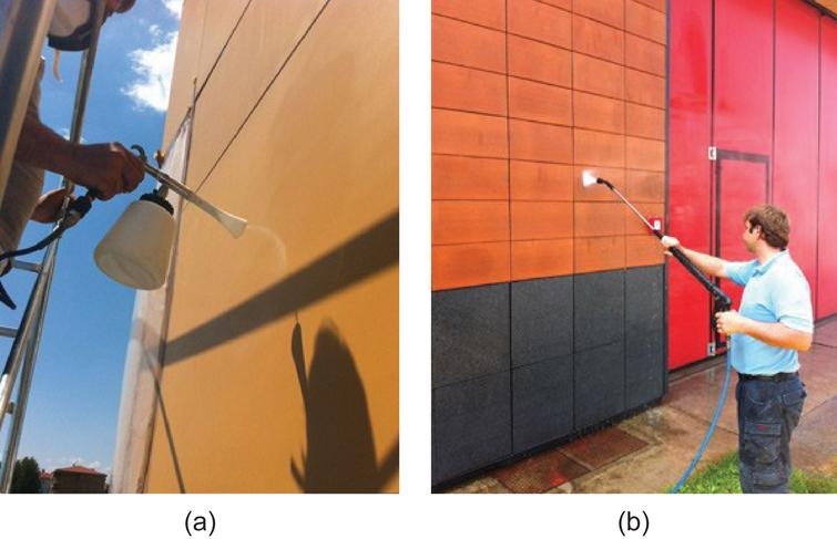 Pressurized spray coating on facade cladding panels.