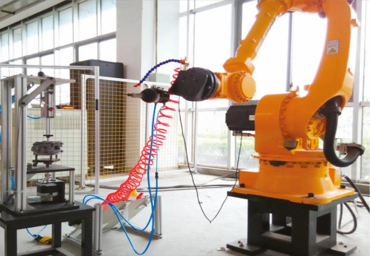The deburring industrial robot system.