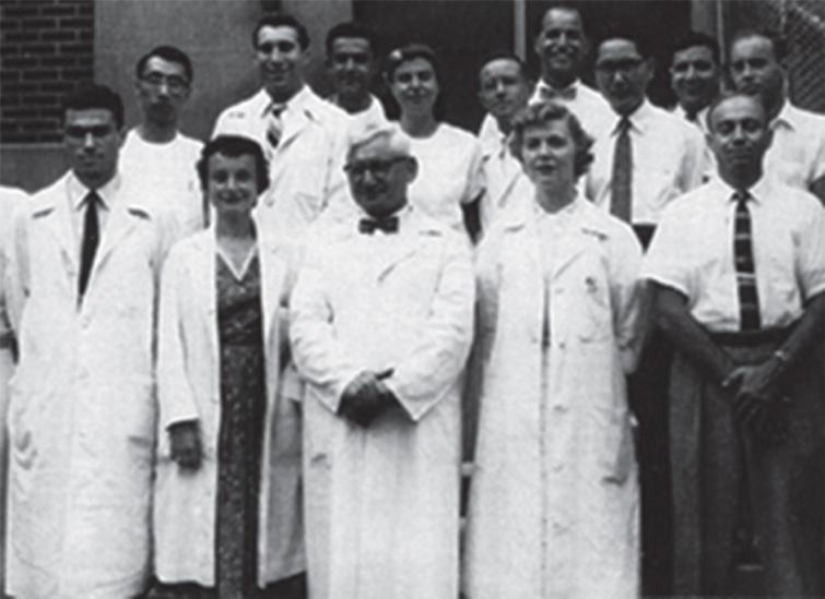 The Neuropathology group at the Montefiore Hospital in the 1950s. Front row (L to R): Bob Terry, Hilda Laufer, Harry Zimmerman, and Lucretia Allen. Back row: Asao Hirano, Nick Gonatas, Kleo Siderides, and Robert Belsky.
