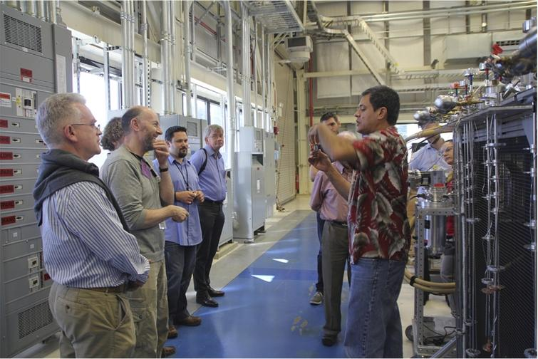 Participants visited the NIST Center for Neutron Research. Here, Juscelino Leão explains the specificities of special sample sticks.