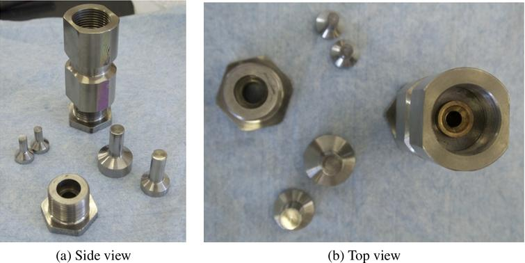 Photographs of the pressure cell, nuts and pistons.