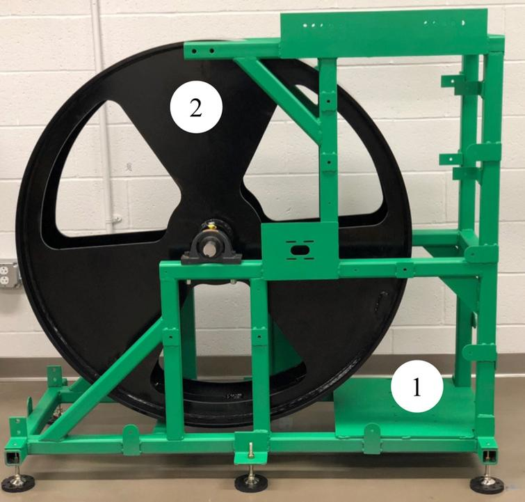 Lower frame assembly with the steel drum. (1) Lower frame, (2) Drum.